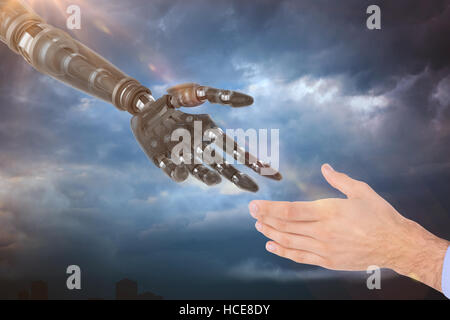 Composite image of businessman holding hand out in presentation - Stock Photo