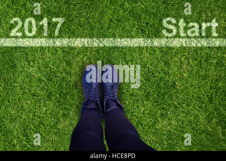 Composite image of cropped image of person wearing shoes - Stock Photo