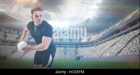 Composite image of rugby player throwing the ball 3D - Stock Photo