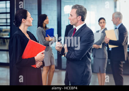 Side view of lawyer interacting with businessman - Stock Photo