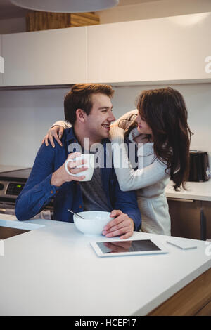 Couple interacting with each other while having breakfast - Stock Photo