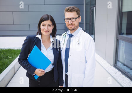 Doctors standing together in hospital premises - Stock Photo