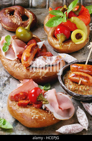 Variety of meat snacks in pretzels - Stock Photo