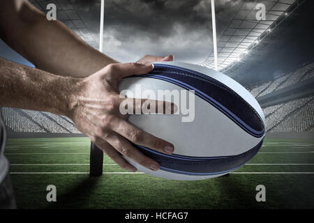 Composite image of cropped image of sports player holding ball 3D - Stock Photo