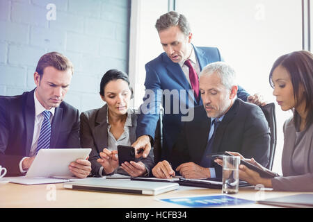 Business people having meeting in conference room - Stock Photo