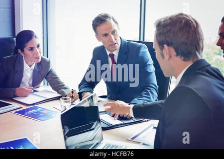 Business people in conference room - Stock Photo