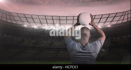 Composite image 3D of rear view of athlete throwing rugby ball - Stock Photo