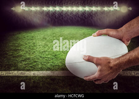 Composite image of sports player holding ball 3D - Stock Photo