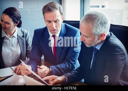 Business people sitting in conference room - Stock Photo