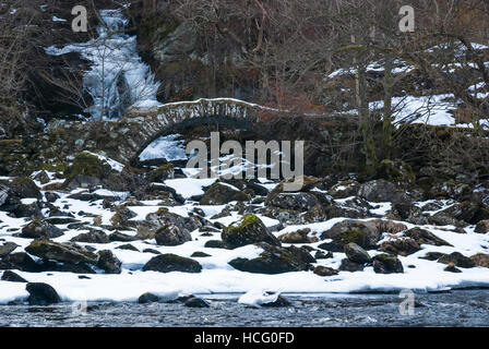 A landscape image of The Pack Horse bridge in Glen Lyon, known locally as the Roman Bridge, Perth and Kinross, Scotland - Stock Photo