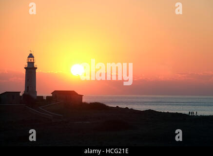 Sun sets behind the Faros lighthouse in the Archaeological Park of Paphos, Cyprus, - Stock Photo