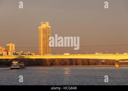 Germany, Cologne, the Zoo bridge across the river Rhine and the skyscraper Colonia-House. - Stock Photo
