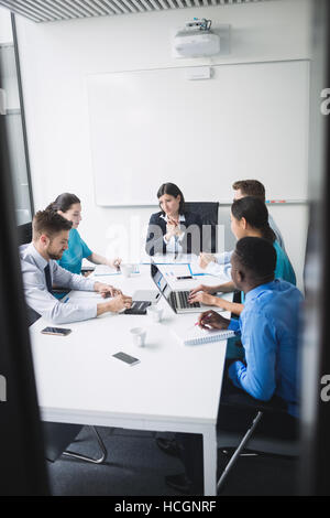 Team of doctors in a meeting - Stock Photo