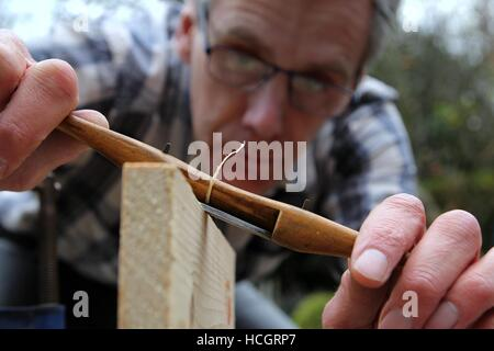 Traditional woodworker using antique boxwood spokeshave - Stock Photo