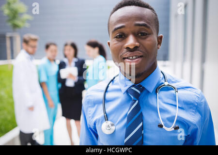 Doctor standing in hospital premises - Stock Photo