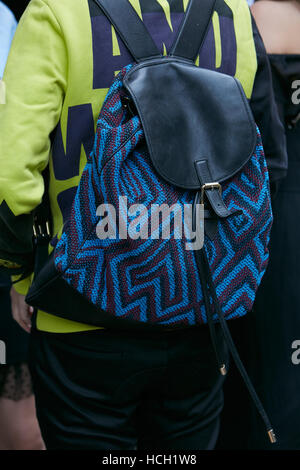 Man with black and blue backpack with geometric design before Max Mara fashion show, Milan Fashion Week street style, - Stock Photo