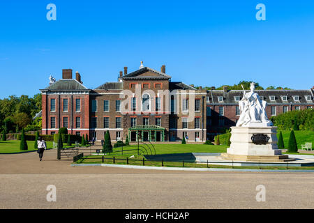Queen Victoria statue and Kensington Palace in London - Stock Photo