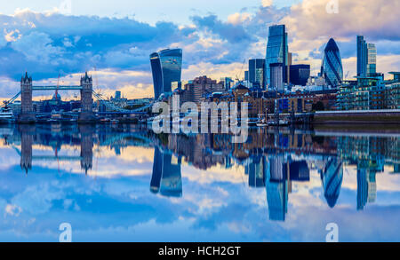 London cityscape and its reflection from river Thames at sunset - Stock Photo