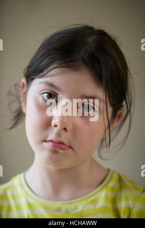 reflective sad looking young girl staring into the distance - Stock Photo