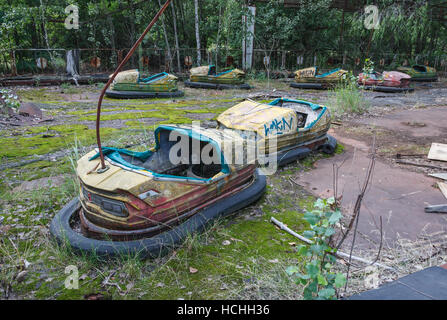 The bumber cars of the Prypiat amusement park. The park has become a symbol of the 1986 Chernobyl nuclear disaster. - Stock Photo