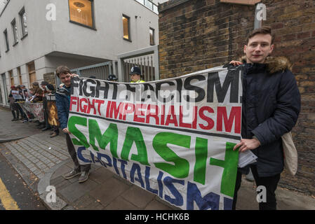 London, UK. 8th December 2016. People hold a banner from 'Fight Racism, Fight Imperialims' with the message 'Smash - Stock Photo