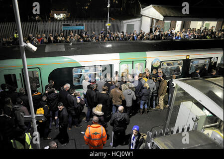 Brighton Sussex, UK. 9th Dec, 2016. Thousands of football fans try to get trains from Falmer Station after watching - Stock Photo