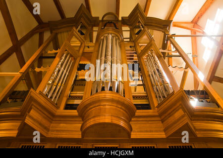A large wooden church organ is slowly assembled (over several months) at the workshop of master piper organ builder - Stock Photo