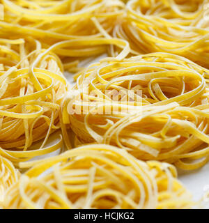 Fettuccine nests dried pasta - Stock Photo
