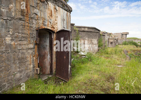 Entrance to abandoned concrete bunker from WWII period on Totleben fort island near Saint-Petersburg city in Russia - Stock Photo