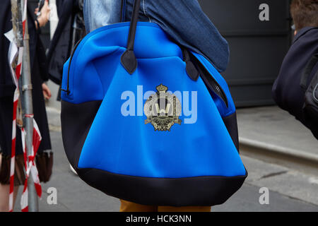Man with Warloom blue bag before Fay fashion show, Milan Fashion Week street style on September 21, 2016 in Milan. - Stock Photo