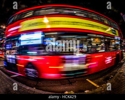 Red London Bus, with Fish Eye lens, Long exposure - Stock Photo