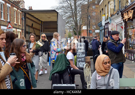 London, UK, 03/04/2016, Hair stylist Columbia road Sunday flower market scenes. - Stock Photo