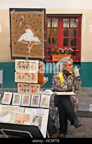Street artist in the 'bohemian' neighborhood of Montmartre, Paris, France - Stock Photo