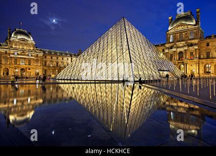The glass pyramid (architect: I.M. Pei) of Louvre museum (Musée du Louvre), Paris, France. - Stock Photo