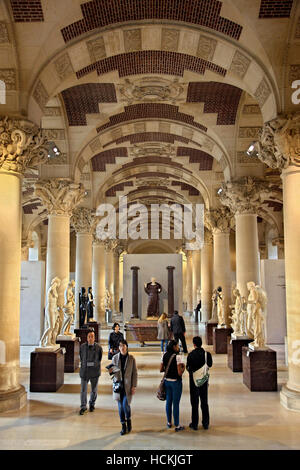 One of the halls of the Denon wing in Louvre museum  dedicated to sculpture. Paris, France. - Stock Photo