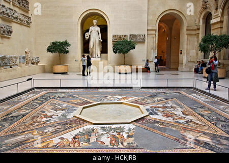 The Sphinx courtyard, with the 'Seasons' mosaic floor and a statue of Melpomene, Denon wing, Louvre museum, Paris, - Stock Photo