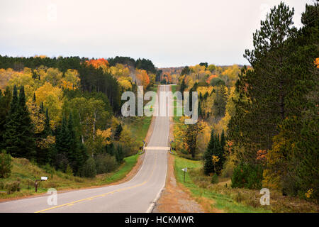 Rural road in northern Wisconsin between Park Falls and Winter. - Stock Photo