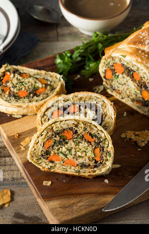 Homemade Holiday Vegan Wellington  with Carrots, Beans, Mushrooms - Stock Photo
