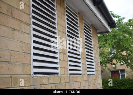 Air ventilation on a brick wall - Stock Photo
