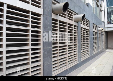Large outdoor air vent on the wall with pipes - Stock Photo