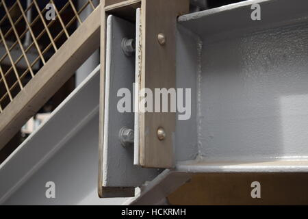Close-up of metallic foundation of wooden stairs - Stock Photo