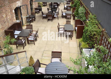 Overhead view of chairs and tables at an outdoor restaurant area - Stock Photo