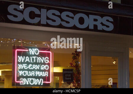 Hairdressing Shops, signs, and shoppers in the retail sector of the City of Chester, Cheshire, UK - Stock Photo