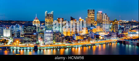 Pittsburgh downtown panorama at dusk viewed from Grandview Overlook across Monongahela River - Stock Photo