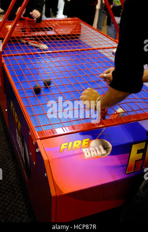 People playing Fire Ball table game - Stock Photo