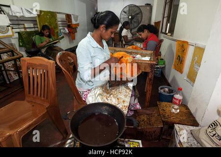 Batik crafting, Sinhalese women, Kandy, Central Province, Sri Lanka - Stock Photo