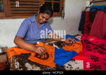 Batik crafting, Sinhalese woman painting, Kandy, Central Province, Sri Lanka - Stock Photo
