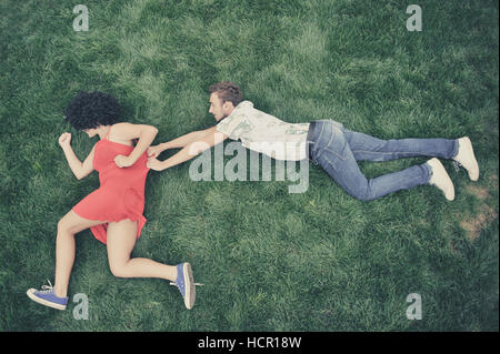 Boy and girl in the grass - Stock Photo