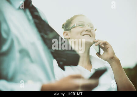 Man and girl talking on the phone - Stock Photo