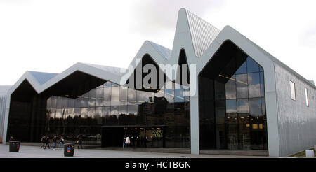 The Riverside Museum on the banks of the River Clyde in Glasgow. It is the city's new transport museum designed - Stock Photo